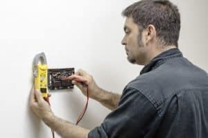 Thermostat check by hvac specialist