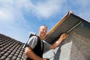 man safely working on a roof