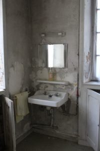 bathroom with mold on the walls